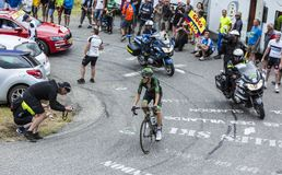 The Cyclist Pierre Rolland - Tour de France 2015. Col du Glandon, France - July 24, 2015: The French cyclist Pierre Rolland of Europcar Team,climbing the road to Stock Photo