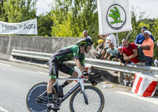 The Cyclist Pierre Rolland - Tour de France 2014. Coursac, France - July 26, 2014: The French cyclist Pierre Rolland  Europcar Team pedaling during the stage 20 Royalty Free Stock Image