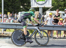 The Cyclist Pierre Rolland - Tour de France 2014. Coursac, France - July 26, 2014: The French cyclist Pierre Rolland  Europcar Team pedaling during the stage 20 Stock Photography