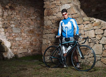 Cyclist posing with his racing bike Stock Images