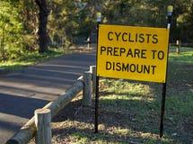 Cyclist prepare to dismount signage stock photos