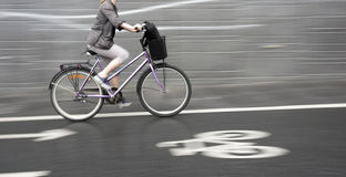 Cyclist on purple bike Stock Images