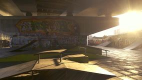 Cyclist and ramp. Sunny skatepark, colorful graffiti. Bike tricks for beginners stock video