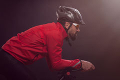 Cyclist in red jacket riding the bike. Extreme sport concept. Stock Images