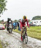 The Cyclist Rein Taaramae on a Cobbled Road - Tour. Ennevelin, France - July 09,2014: The Estonian cyclist Rein Taaramae (Cofidis Team) riding on a cobbled road Royalty Free Stock Photos