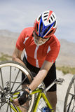 Cyclist Repairing Cycle Royalty Free Stock Images