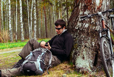 Cyclist resting in a tree Stock Images