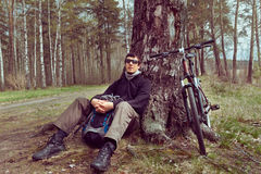 Cyclist rests in the forest Royalty Free Stock Images