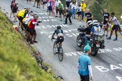 The Cyclist Richie Porte - Tour de France 2015. Col du Glandon, France - July 24, 2015: The Australian cyclist Richie Porte has technical difficulties while Stock Photo