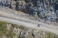 Cyclist ride bicycle mountain uphill royalty free stock image