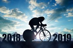 Cyclist ride on a road bicycle at sunset.New Year 2019 concept. Cyclist ride on a road bicycle at sunset. Forward to the New Year 2019 royalty free stock images