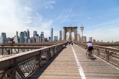 Cyclist rides across the Brooklyn Bridge in New York Royalty Free Stock Photography