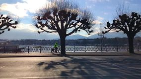 Cyclist rides along the bike path in the city. Geneva. Switzerland stock video footage