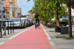 Cyclist rides his bicycle on the bikepath Stock Photo