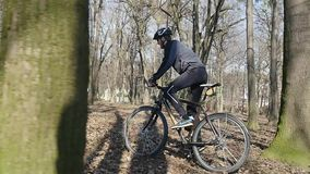 Cyclist rides in the park. Autumn leaves on the ground stock video footage