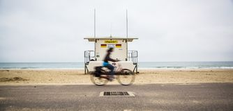 Cyclist Rides passed a Life Guard Station Stock Image