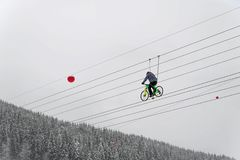 A cyclist rides on a rope. extreme attraction Stock Images