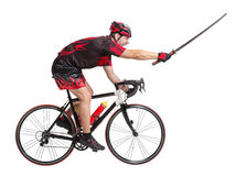Cyclist rides with samurai sword Stock Photo