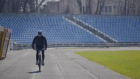 Cyclist rides on a stadium stock video footage