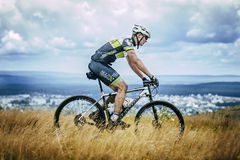 Cyclist rides on top of a mountain Royalty Free Stock Photo