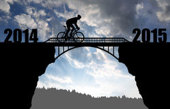 Cyclist riding across the bridge at sunset Stock Photography