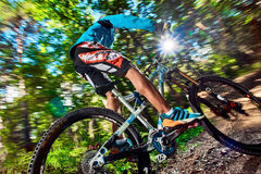 Cyclist riding with aggressive turns Royalty Free Stock Image