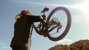 Cyclist riding a bicycle. Downhill. Extreme Sport Biking Concept stock photography