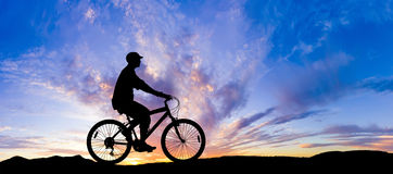 Cyclist Riding Bicycle Stock Photo