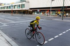 Cyclist riding bicycles on street Stock Images