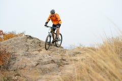 Cyclist Riding Bike on the Beautiful Autumn Mountain Trail Royalty Free Stock Photos