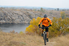 Cyclist Riding Bike on the Beautiful Autumn Mountain Trail under River Stock Photos