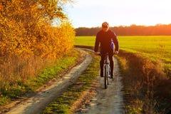 Cyclist Riding the Bike. On the Beautiful Autumn Scene stock photo