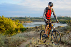 Cyclist Riding the Bike on the Beautiful Spring Mountain Trail Royalty Free Stock Photography