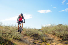 Cyclist Riding the Bike on the Beautiful Spring Mountain Trail Royalty Free Stock Photos