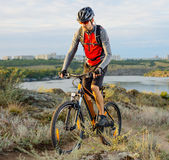 Cyclist Riding the Bike on the Beautiful Spring Mountain Trail Stock Photo