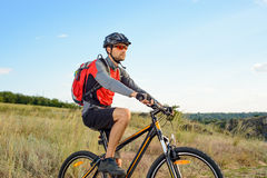 Cyclist Riding the Bike on the Beautiful Summer Mountain Trail. Sport Concept. Royalty Free Stock Photo