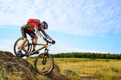 Cyclist Riding the Bike Down Rocky Hill Royalty Free Stock Images