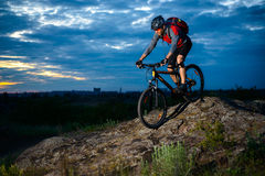 Cyclist Riding the Bike on the Mountain Rocky Trail at Sunset Royalty Free Stock Photos