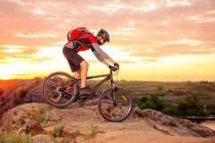 Cyclist Riding the Bike on the Mountain Rocky Trail at Sunset Stock Image