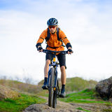 Cyclist Riding the Bike in the Mountains Stock Photography