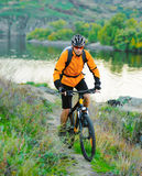 Cyclist Riding the Bike in the Mountains Royalty Free Stock Photo