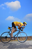 Cyclist riding a bike on an open road. In Macedonia Stock Images