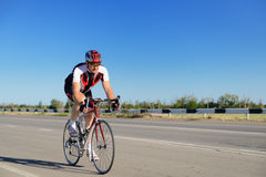 Cyclist. Riding a bike on an open road stock photos
