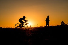 Cyclist riding Bike Stock Images