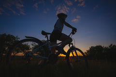 cyclist riding bike at sunset Royalty Free Stock Photos