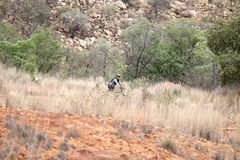 Cyclist riding down mountain at Mountain Bike Race Royalty Free Stock Photo