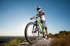 Cyclist riding downhill on mountain bike on the hill Stock Photography