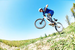 Cyclist riding jumping with bicycle cross-country Royalty Free Stock Images