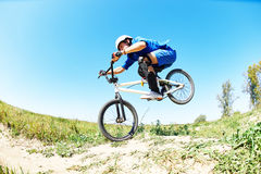 Cyclist riding jumping with bicycle cross-country Stock Image