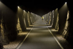 Cyclist riding through long tunnel along the Two Tunnels Greenway near Bath, Somerset, England. Stock Image